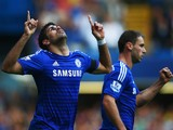 Diego Costa of Chelsea celebrates alongside Branislav Ivanovic as he scores their second goal during the Barclays Premier League match between Chelsea and