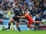 Ian Whitten of Exeter Chiefs is tackled by Anthony Allen of Leicester Tigers during the Aviva Premiership match between Exeter Chiefs and Leicester Tigers at Sandy Park on September 13, 2014