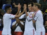 Wales forward Gareth Bale (C) celebrates with teammates forward Simon Church (R) and defender Lewin Nyatanga after scoring a goal during the Euro 2016 qualifying round match against Andorra on September 9, 2014