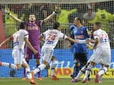 Lyon's French midfielder Corentin Tolisso celebrates with teammates after scoring during the French L1 football match Lyon (OL) vs Monaco (ASMFC) on September 12, 2014