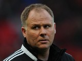 West Ham United Assistant Manager Neil McDonald looks on prior to the Barclays Premier League match between Manchester United and West Ham United at Old Trafford on December 21, 2013