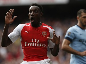Arsenal's English striker Danny Welbeck reacts after a shot at goal hit the post during the English Premier League football match between Arsenal and Manchester City at the Emirates Stadium in London on September 13, 2014