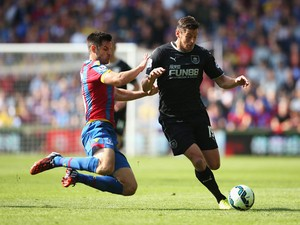 Lukas Jutkiewicz of Burnley is challenged by Scott Dann of Crystal Palace during the Barclays Premier League match between Crystal Palace and Burnley at Selhurst Park on September 13, 2014