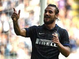 Inter Milan's forward Pablo Osvaldo celebrates after scoring during the Italian Serie A football match Inter vs Sassuolo, on September 14, 2014