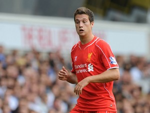 Liverpool's Spanish defender Javier Manquillo runs with the ball during the English Premier League football match between Tottenham Hotspur and Liverpool at White Hart Lane in London on August 31, 2014