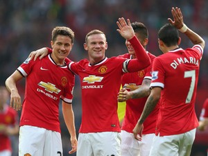 Wayne Rooney of Manchester United celebrates scoring the third goal with team-mates Ander Herrera (L), Marcos Rojo and Angel Di Maria during the Barclays Premier League match between Manchester United and Queens Park Rangers at Old Trafford on September 1