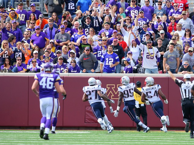 Chandler Jones #95 of the New England Patriots blocks and returns a field goal attempt by the Minnesota Vikings for a touchdown at TCF Bank Stadium on September 14, 2014