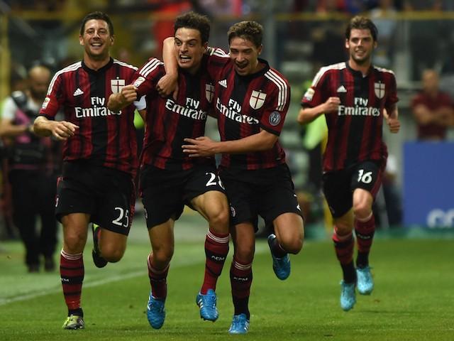 Giacomo Bonaventura (C) of AC Milan celebrates the opening goal during the Serie A match between Parma FC and AC Milan at Stadio Ennio Tardini on September 14, 2014