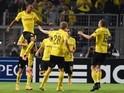 Dortmund's Gabonese striker Pierre-Emerick Aubameyang (L) celebrates scoring with his teammates during the first leg UEFA Champions League Group D football match against Arsenal on September 16, 2014