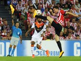 Shakhtar Donetsk's Brazilian forward Luiz Adriano vies with Athletic Bilbao's French defender Aymeric Laporte during the UEFA Champions League football match Athletic Club Bilbao vs FC Shakhtar Donetsk at the San Mames stadium in Bilbao on September 17, 2