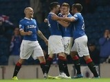 Darren McGregor (2-R) of Rangers celebrates his goal with teammate Lewis McLeod during the Scottish League Cup match between Rangers and Inverness in Glasgow on September 16, 2014