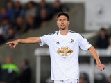 Swansea player Federico Fernandez in action during the Capital One Cup Second Round match between Swansea City and Rotherham United at Liberty Stadium on August 26, 2014