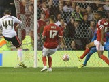 Ross McCormack of Fulham scores their third goal during the Sky Bet Championship match between Nottingham Forest and Fulham at the City Ground on September 17, 2014