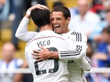 Javier Hernandez of Real Madrid CF celebrates with his teammate Isco after scoring against Deportivo on September 20, 2014