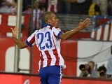 Atletico Madrid's Brazilian defender Joao Miranda celebrates after scoring during the Spanish league football match Club Atletico de Madrid vs Celta de Vigo on September 20, 2014
