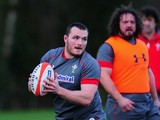 Wales forward Ken Owens in action as Adam Jones looks on during the Wales training session at the Vale Hotel on February 11, 2014