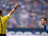 Referee Markus Schmidt shows the red card to Schalke's midfielder Julian Draxler during the German first division Bundesliga football match FC Schalke 04 vs Eintracht Frankfurt at the Veltins Arena in Gelsenkirchen, western Germany on September 20, 2014