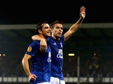Seamus Coleman (R) of Everton celebrates with teammate Leighton Baines of Everton after scoring his team's second goal during the UEFA Europa League against Wolfsburg on September 18, 2014