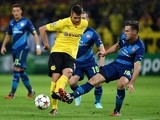Dortmund's midfielder Sebastian Kehl (L) and Arsenal's Welsh midfielder Aaron Ramsey vie for the ball during the first leg UEFA Champions Leagu