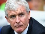 Mark Hughes, manager of Stoke City looks on during the Barclays Premier League match between Queens Park Rangers and Stoke City at Loftus Road on September 20, 2014