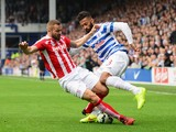 Armand Traore of QPR is tackled by Phil Bardsley of Stoke City during the Barclays Premier League match between Queens Park Rangers and Stoke City at Loftus Road on September 20, 2014