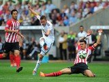 Gylfi Sigurdsson of Swansea shoots at goal during the Barclays Premier League match between Swansea City and Southampton at Liberty Stadium on September 20, 2014