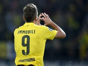 Dortmund's Italian striker Ciro Immobile celebrates scoring the 1-0 goal with during the first leg UEFA Champions League Group D football match against Arsenal on September 16, 2014