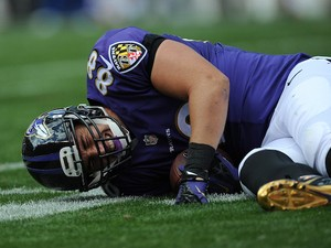 Dennis Pitta #88 of the Baltimore Ravens is injured during the second quarter against the Cleveland Browns at FirstEnergy Stadium on September 21, 2014