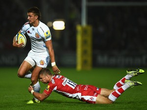 Chiefs player Henry Slade breaks the tackle of Gloucester centre Henry Purdey during the Aviva Premiership match between Gloucester Rugby and Exeter Chiefs at Kingsholm Stadium on September 19, 2014