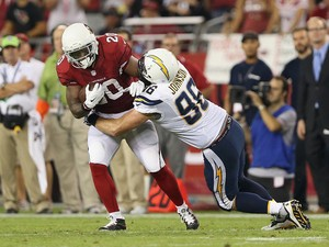 Running back Jonathan Dwyer #20 of the Arizona Cardinals rushes the football against outside linebacker Jarret Johnson #96 of the San Diego Chargers during the NFL game at the University of Phoenix Stadium on September 8, 2014