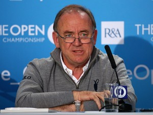 Peter Dawson, Chief Executive of the R&A talks to the media during a practice round prior to the start of The 143rd Open Championship at Royal Liverpool on July 16, 2014