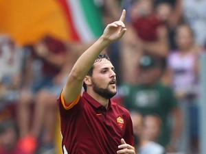 Mattia Destro of AS Roma celebrates after scoring the opening goal during the Serie A match between AS Roma and Cagliari Calcio at Stadio Olimpico on September 21, 2014