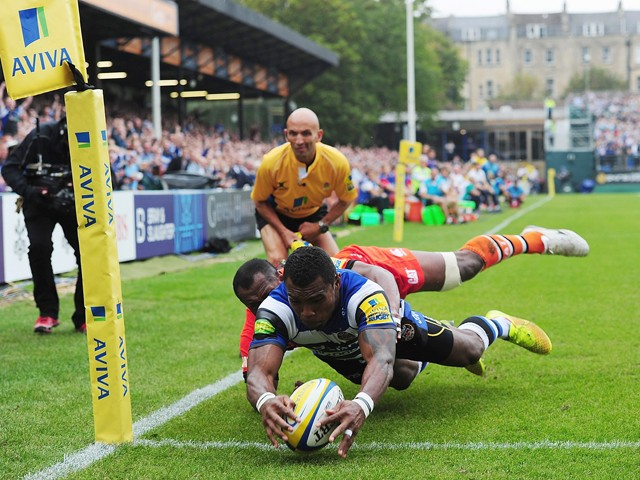 Semesa Rokoduguni of Bath scores the opening try past Vereniki Goneva of Leicester Tigers during the Aviva Premiership match between Bath and Leicester Tigers at the Recreation Ground on September 20, 2014