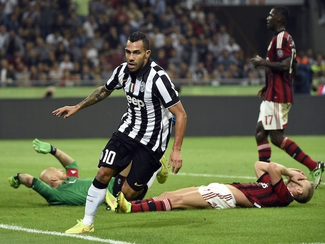 Juventus Argentinian foward Carlos Tevez celebrates after scoring during the Serie A match AC Milan against Juventus, on September 20, 2014