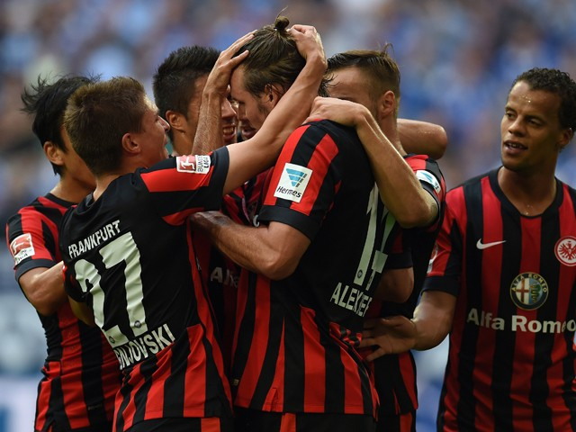 Frankfurt's midfielder Alexander Meier and his teammates celebrate after scoring during the German first division Bundesliga football match FC Schalke 04 vs Eintracht Frankfurt at the Veltins Arena in Gelsenkirchen, western Germany on September 20, 2014
