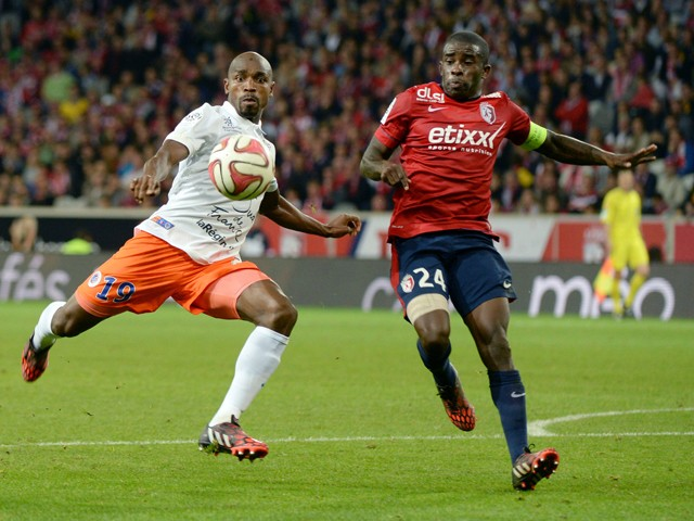 Lille's Montenegran defender Marko Basa vies with Montpellier's Senegalese forward Souleymane Camara during a French L1 football match between Lille and Montpellier on September 21, 2014
