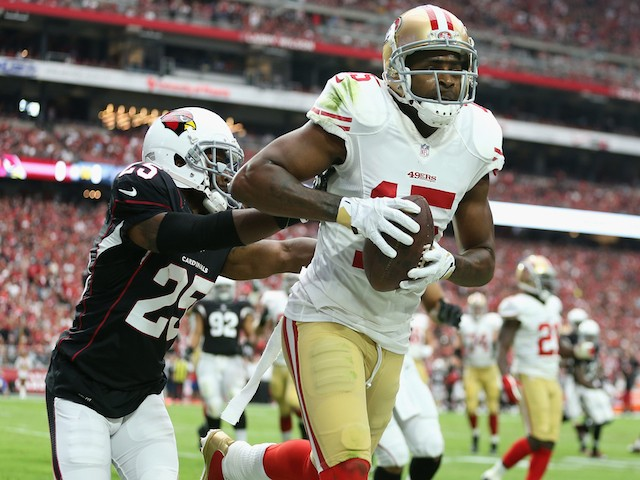 Wide receiver Michael Crabtree #15 of the San Francisco 49ers catches a touchdown pass over Cornerback Jerraud Powers #25 of the Arizona Cardinals on September 21, 2014