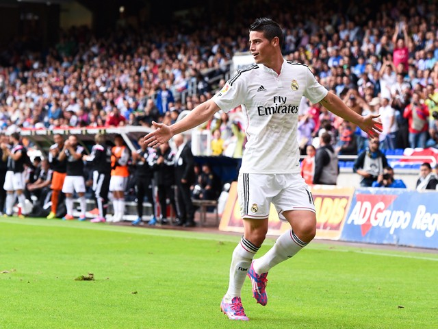 James Rodriguez of Real Madrid CF celebrates after scoring his team's second goal during the La Liga match between RC Deportivo La Coruna and Real Madrid CF at Riazor Stadium on September 20, 2014