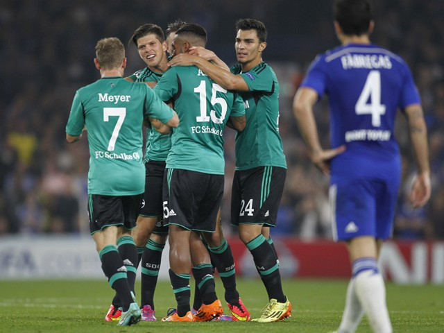Schalke's Netherlands striker Klaas Jan Huntelaar celebrates scoring his goal during the UEFA Champions League, group G football match between Chelsea and Schalke 04 at Stamford Bridge, in London on September 17, 2014