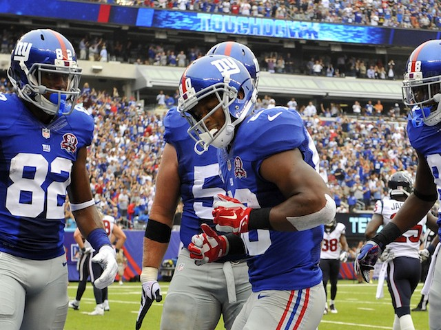 Victor Cruz #80 of the New York Giants celebrates his touchdown with a dance against the Houston Texans in the second quarter at MetLife Stadium on September 21, 2014