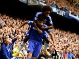 Diego Costa of Chelsea is congratiulated by teammate Willian of Chelsea after scoring his team's second goal during the Barclays Premier League match between Chelsea and Aston Villa at Stamford Bridge on September 27, 2014