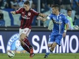 AC Milan's Spanish forward Fernando Torres (L) fights for the ball with Empoli's midfielder Mirko Valdifiori during the Italian Serie A football match Empoli vs AC Milan on September 23, 2014