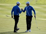 Justin Rose (R) of Europe celebrates his birdie with Henrik Stenson on the 4th hole during the Morning Fourballs of the 2014 Ryder Cup on the PGA Centenary course at Gleneagles on September 26, 2014