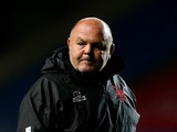 London Welsh head coach Justin Burnell looks on prior to the Aviva Premiership match between London Welsh and Gloucester Rugby at Kassam Stadium on September 26, 2014