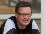 Leyton Orient assistant manager Kevin Nugent looks on prior to the Pre-Season Friendly match between Northampton Town and Leyton Orient at Sixfields Stadium on July 26, 2014