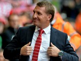 Liverpool's Northern Irish manager Brendan Rodgers arrives for the English Premier League football match between Liverpool and Everton at Anfield in Liverpool, north west England on September 27, 2014