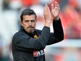 Oscar Garcia Manager of Watford claps the away support after the Sky Bet Championship match between Charlton Athletic and Watford at The Valley on September 13, 2014