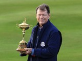 Team USA captain Tom Watson poses with the Ryder Cup ahead of the contest against Europe at Gleneagles on September 23, 2014