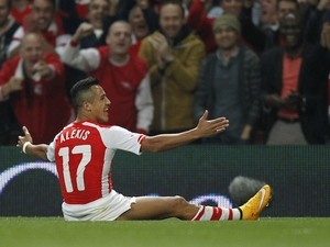 Arsenal's Chilean striker Alexis Sanchez celebrates scoring the opening goal from a freekick during the English League Cup third round football match against Southampton on September 23, 2014
