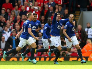 Phil Jagielka of Everton celebrates with teammates after scoring a late goal to level the scores at 1-1 during the Barclays Premier League match between Liverpool and Everton at Anfield on September 27, 2014